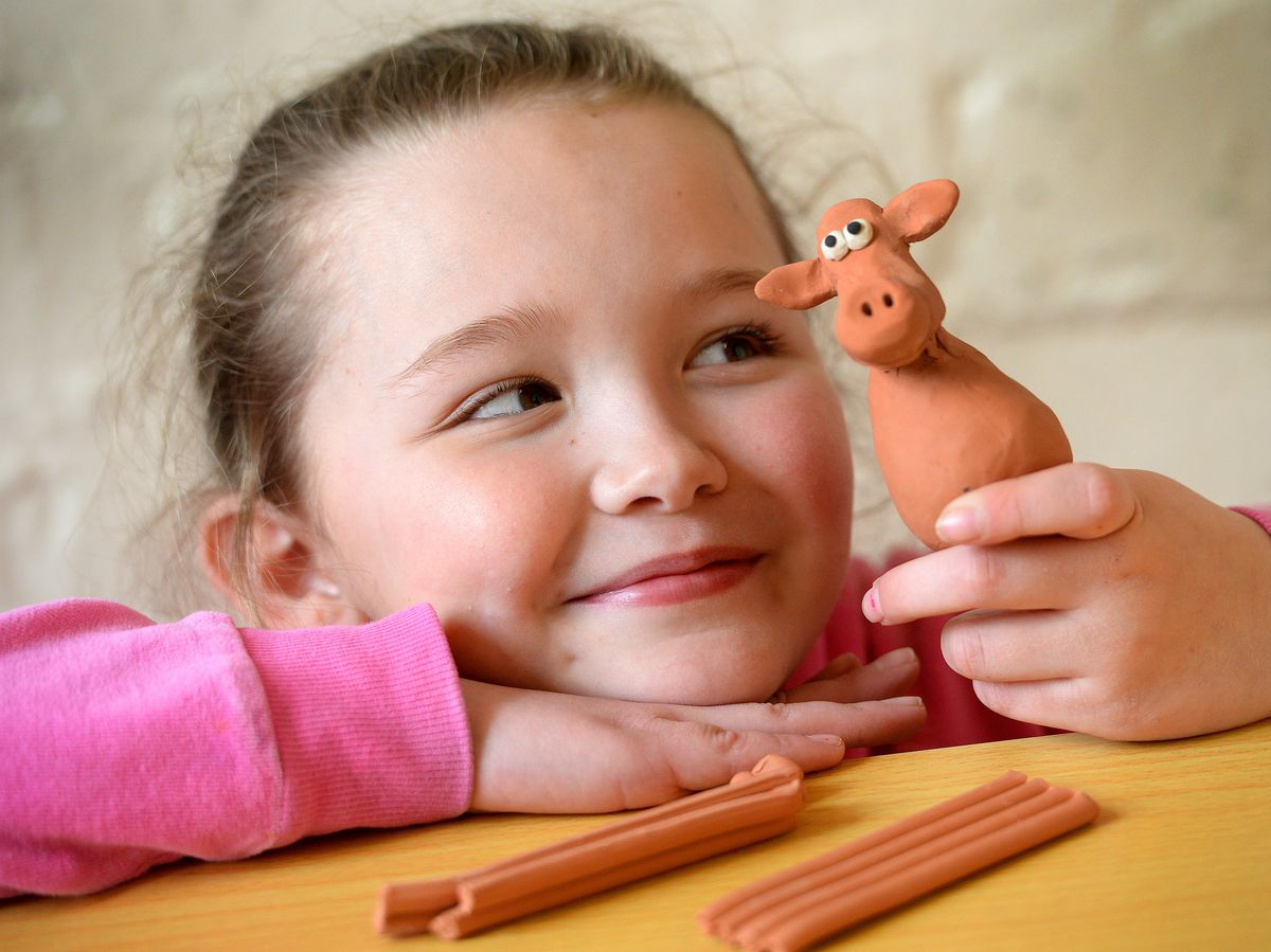 Pupil Grace Finney, aged 9, with one of the models created during the session.
