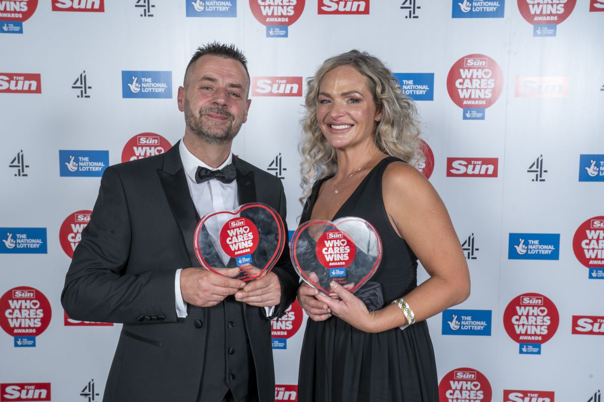 Michael Hipgrave and Deena Evans with their awards