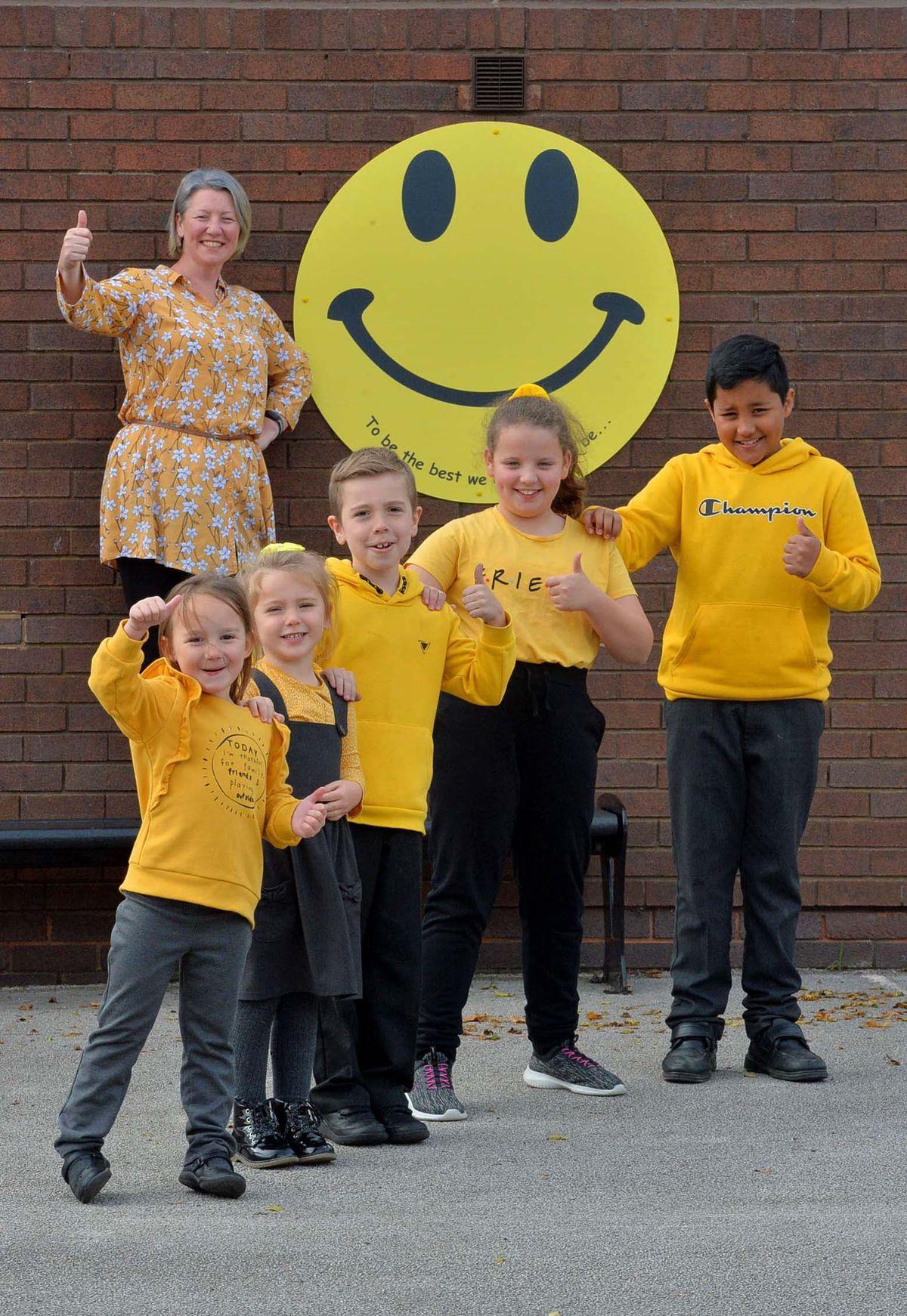 Life coach Nicki Hamilton with pupils Lilly Winsper, 5, Emilyn Leach, 4, Charlie Morris, 8, Grace Lloyd, 9, and Avi Bal, 11