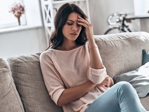 A generic stock photo of a woman feeling stressed.