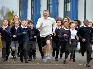 Tom Watson with the children at Hargate Primary School in West Bromwich