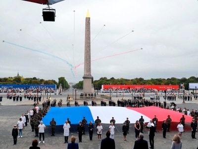 France says 'merci' to virus heroes on poignant Bastille Day