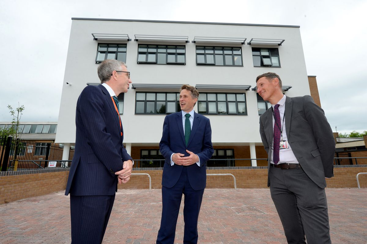 Gavin Williamson with headteacher Glyn Langston-Jones and Richard Gill, CEO at Arthur Terry Learning Partnership, next to the new building..