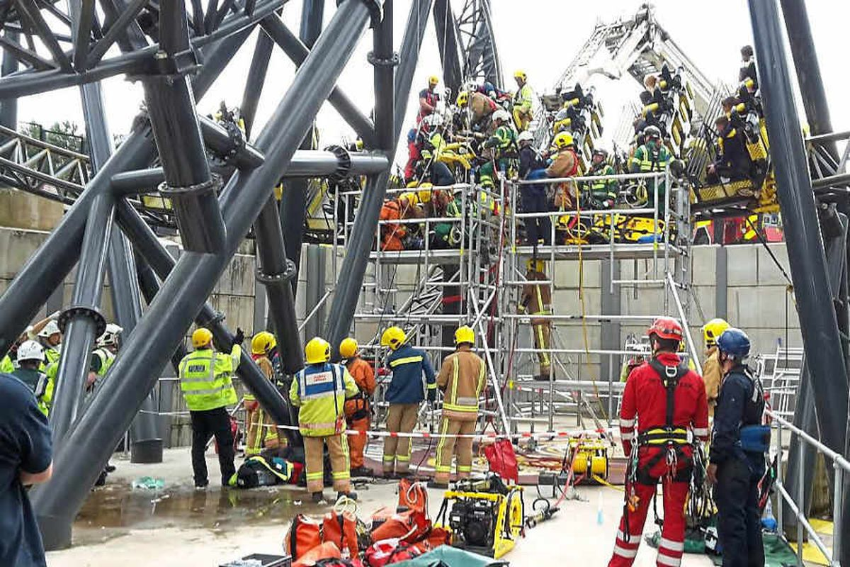 Emergency services work to free those trapped on the Smiler ride in June last year