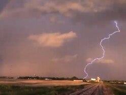 Lightning strikes inside rainbow in 'special' footage