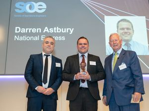 7th October 2021  SOE Safety and Sustainability Awards 2021 hosted at Jaguar Experience, Castle Bromwich, Birmingham.  Mike Byrne (left), Sales and Marketing Director from category sponsor - FCL Organisation joins Sir John Parker (right) onstage to present the award to Darren Astbury of National Express.  Photo by Tim Gander. © Tim Gander 2021. All rights reserved.