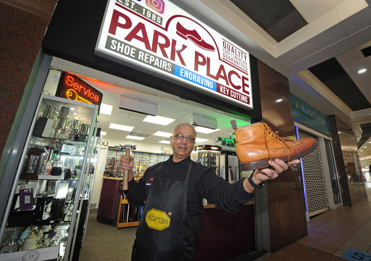 Owner Kishor Chauhan, outside Park Place Shoe Repairs, at Saddlers Shopping Centre in Walsall. The shop was given a new home after having to leave the Quasar Shopping Centre