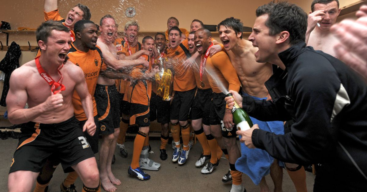 Players of Wolverhampton Wanderers celebrate with the trophy after winning the Coca Cola Football League Championship in the dressing room.