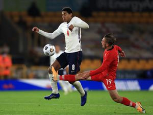 England's Jude Bellingham (left) and Turkey's Serkan Asan battle for the ball during the UEFA Euro 2021 Under-21 Qualifying Group 3 match at Molineux, Wolverhampton. PA Photo. Picture date: Tuesday October 13, 2020. See PA story SOCCER England U21. Photo credit should read: Mike Egerton/PA Wire. RESTRICTIONS: Use subject to FA restrictions. Editorial use only. Commercial use only with prior written consent of the FA. No editing except cropping.